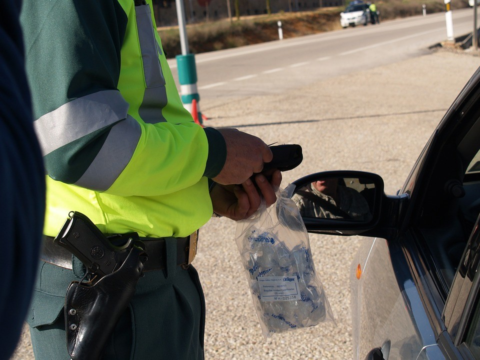 an officer trying to give a driver a breathalyzer test